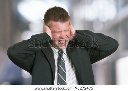 Businessman with stress headache - stock photo