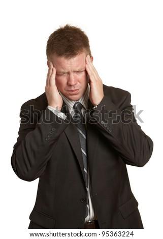 Businessman with stress pain headache holding head - stock photo