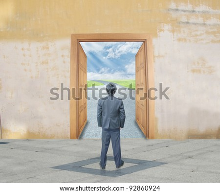 Businessman with success door - stock photo