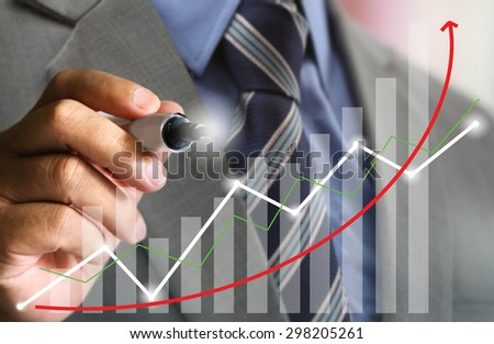 businessman with suit write stock chart trend up,businessman hand pushing a business graph on a touch screen interface, business news background, hardworking good result, banker management financial