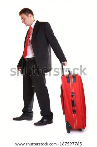 Businessman with suitcase against white background - stock photo