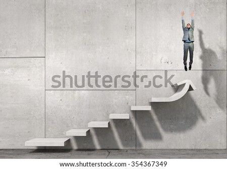 Businessman with suitcase jumping up stone staircase - stock photo
