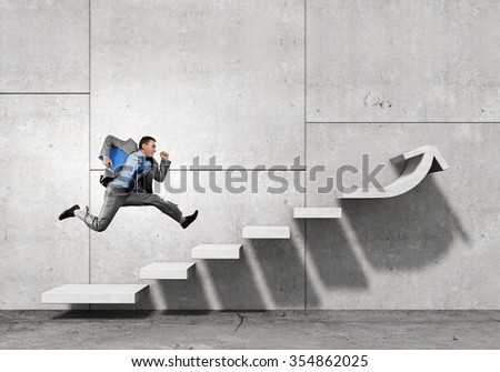 Businessman with suitcase running on stone staircase - stock photo