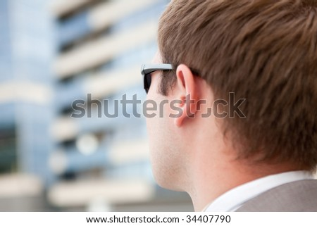 Businessman with sunglasses - stock photo