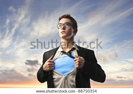 Businessman with superhero suit under his skirt - stock photo