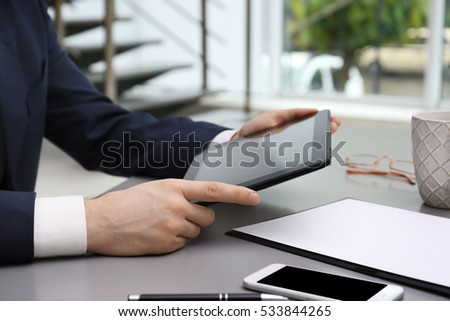 Businessman with tablet in office