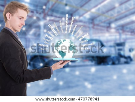 Businessman with tablet on hand show supply chain concept logistics import export over the world,distribution goods at warehousing background. (Elements of this image furnished by NASA)