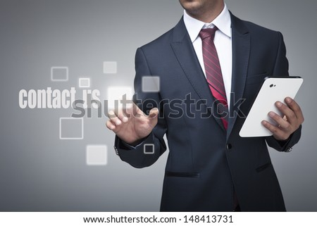 Businessman with tablet pushing on a contact us button - stock photo