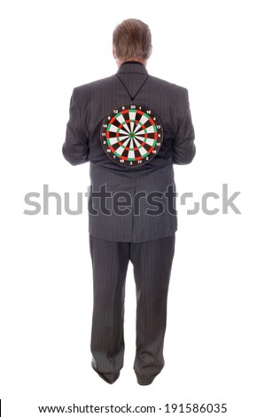Businessman with target on his back isolated on white - stock photo