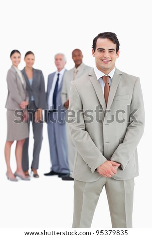 Businessman with team behind him against a white background