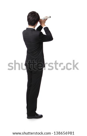 Businessman with telescope ( spyglass ) looking forward Prospects for future business. full length, isolated on white background, asian model - stock photo