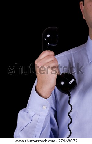 businessman with the telephone receiver in the hand (isolated on black) - stock photo