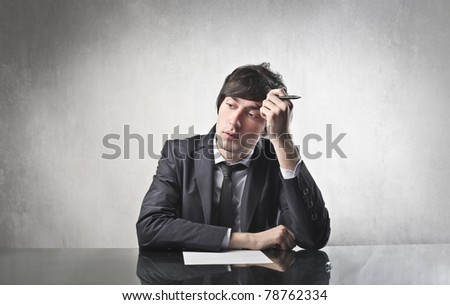 Businessman with thoughtful expression - stock photo