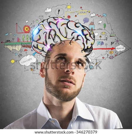 Businessman with thoughtful expression with brains designed - stock photo