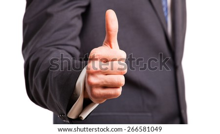 businessman with thumb up gesture - stock photo