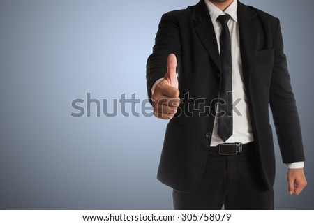 businessman with thumbs up gesture  isolated on blue background