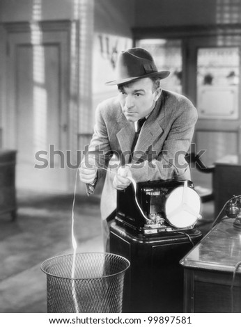Businessman with ticker tape machine