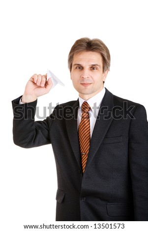 businessman with toy airplane in hand - stock photo