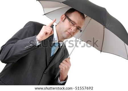 Businessman with umbrella pointing index finger