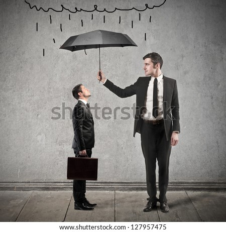businessman with umbrella protects from rain another man - stock photo