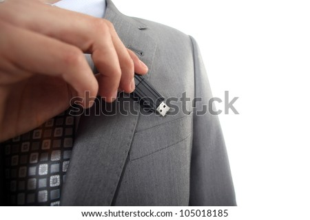 Businessman with USB key in hand - stock photo