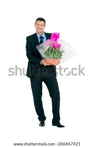 businessman with vase of flowers - stock photo