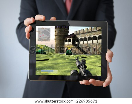 businessman with videogame tablet - stock photo