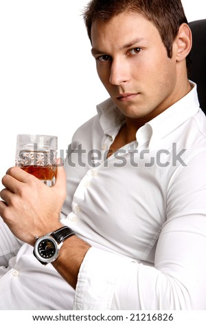 Businessman with watch holding a glass with drink