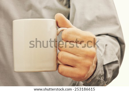 Businessman with white coffee cup, refreshment and morning coffee break in the office during working hours. - stock photo