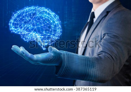 businessman with wire frame hand holding glow abstract brain structure - stock photo