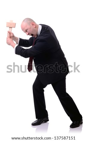 Businessman with wooden mallet hitting against side of image isolated on white