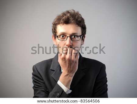 Businessman with worried expression - stock photo