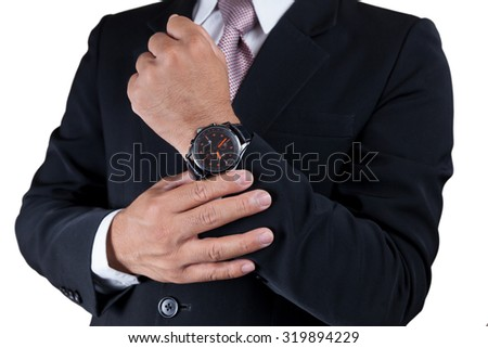 Businessman with wrist watch isolated on white. - stock photo