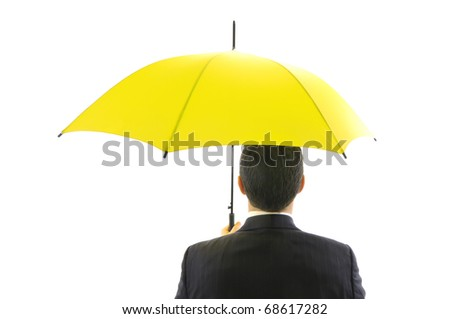 Businessman with yellow umbrella isolated on white background - protection concept.