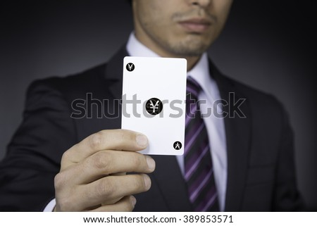 businessman with yen card