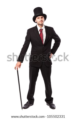 Businessman with Yop Hat and walking stick in a suite - stock photo