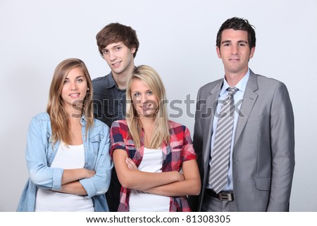 Businessman with young people - stock photo