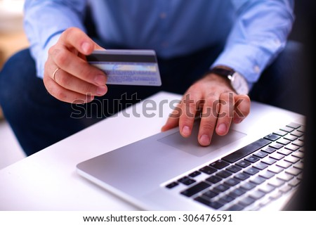 businessman working at a computer hands closeup
