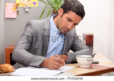 Businessman working at his breakfast bar