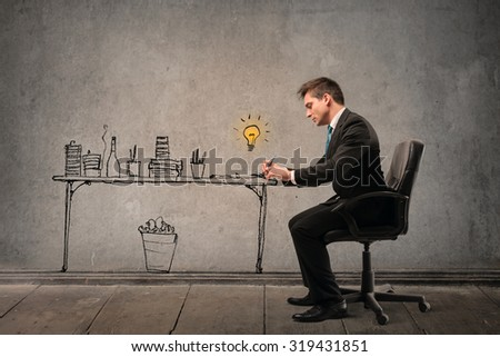 Businessman working at his desk - stock photo