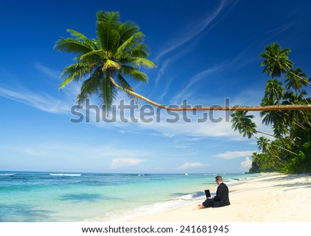 Businessman working at the beach. - stock photo