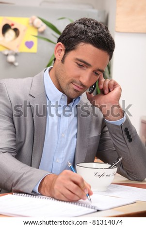 Businessman working at the breakfast table