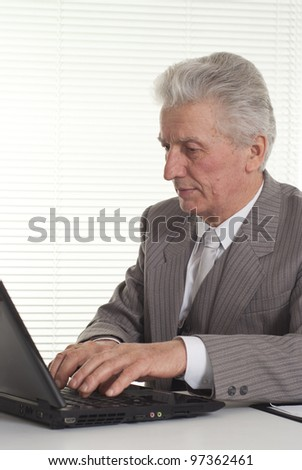 Businessman working at the computer on a light background