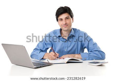 Businessman working at the desk over white background - stock photo