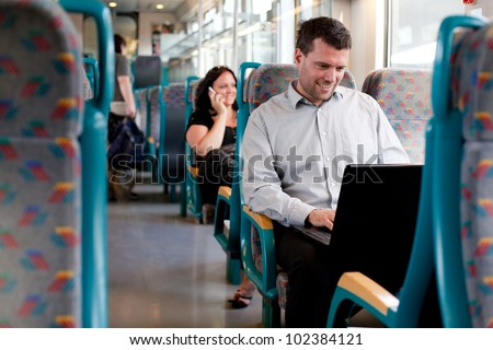 Businessman working during a business trip - stock photo