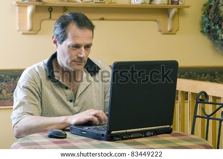 Businessman working from home - stock photo