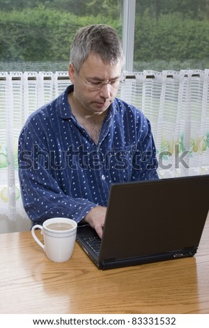 Businessman working from home in pajamas (SUMMER) - stock photo