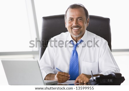 Businessman working hard at desk - stock photo