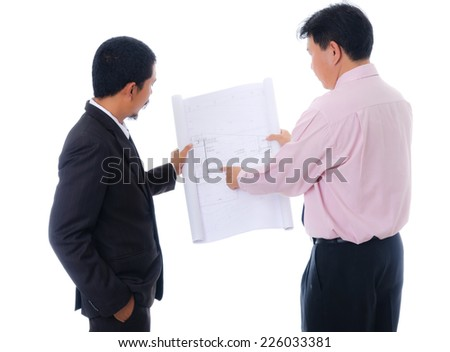 Businessman working hard, isolated on the white background. - stock photo