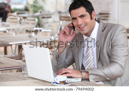 Businessman working in a cafe - stock photo